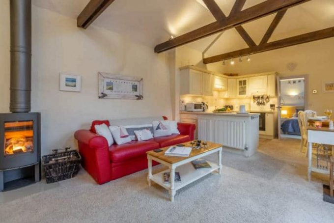 Open plan living room with woodburner