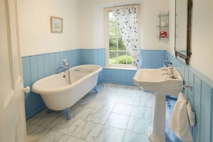 Large bathroom with roll top bath