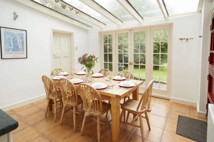 Bright sun room and dining room